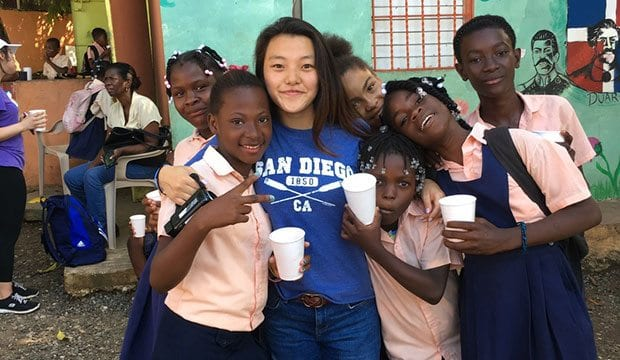 Min Ah Lee in the Dominican Republic poses with students