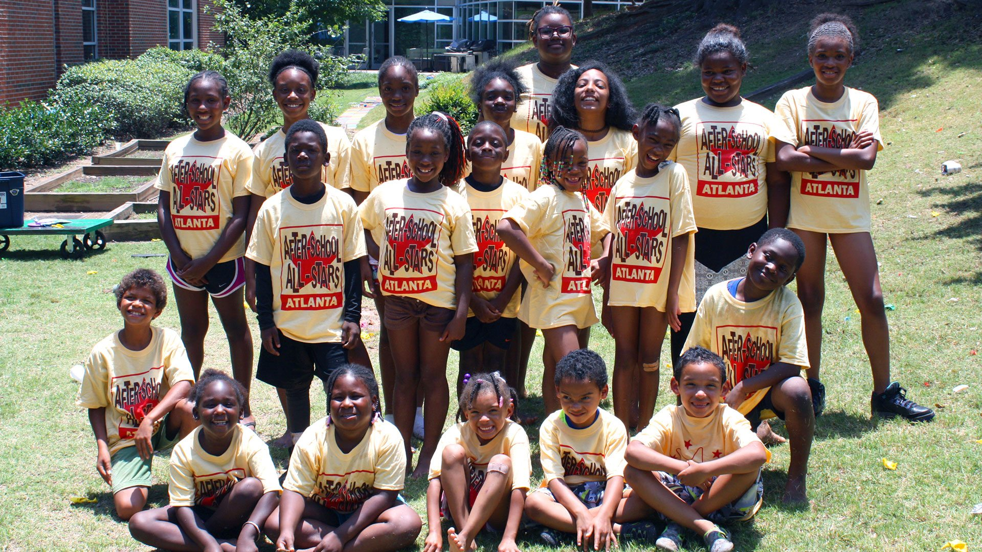 After-School All-Stars pose for a group photo in their summer ASAS t-shirts