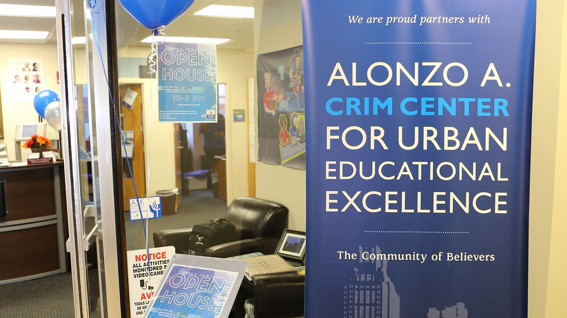 Banner reads Alonzo A. Crim Center for Urban Educational Excellence - The Community of Believers