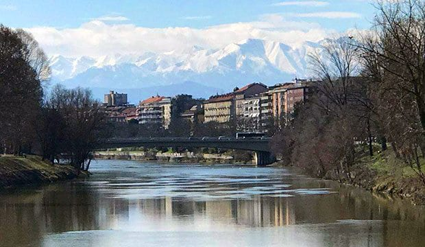 River in Italy with Alps in background