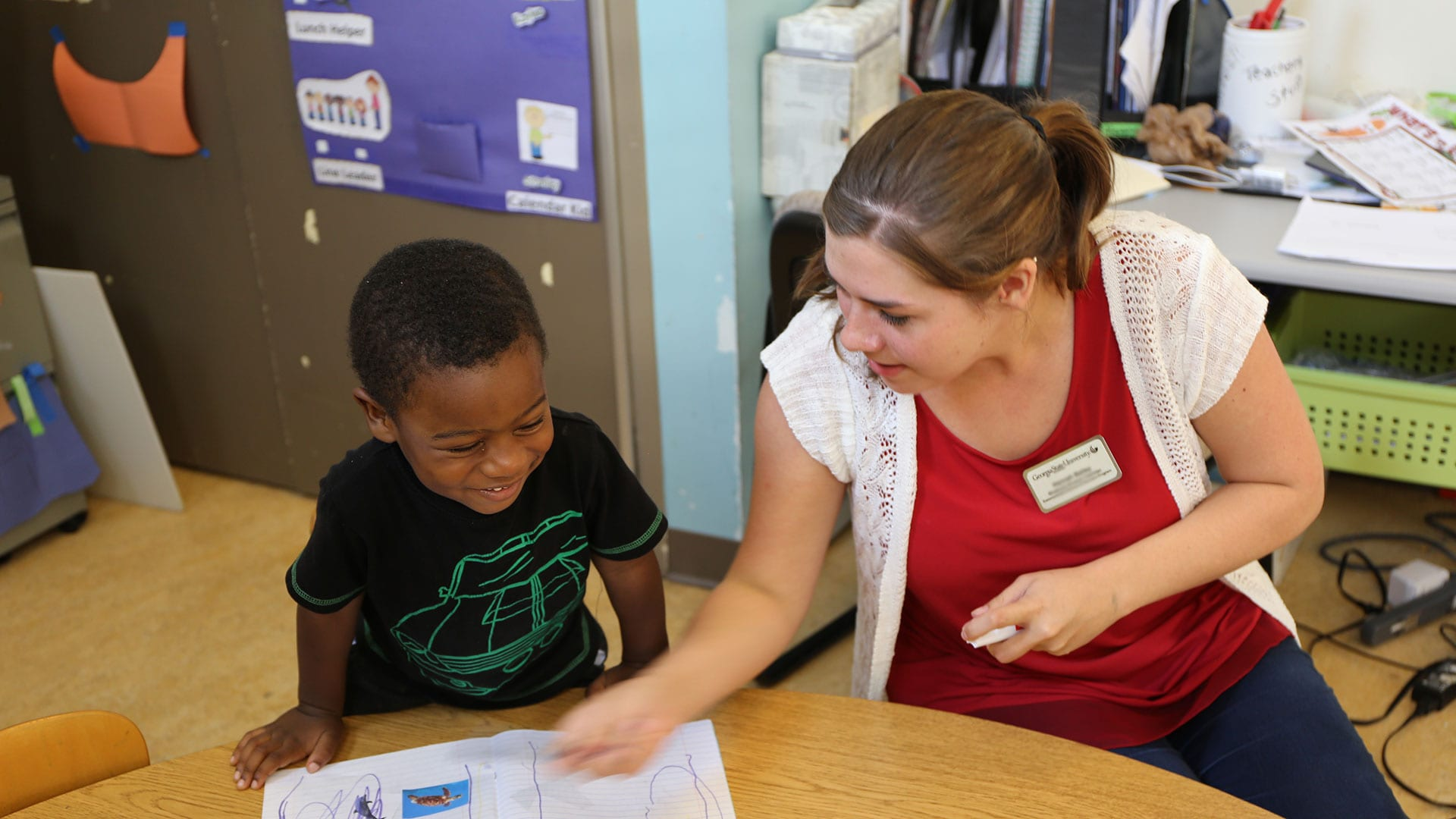 Student works with child at the Atlanta Children's Center